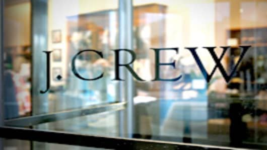A J. Crew logo is seen on a glass door of one of its retail clothing stores in Chicago, Illinois.