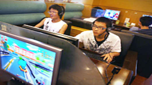 Chinese students play online computer games at an internet cafe in Hangzhou.