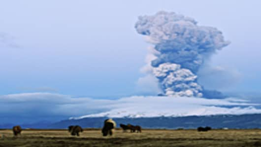 A cloud of volcanic matter rises from the erupting Eyjafjallajokull volcano, April 16, 2010 in Fimmvorduhals, Iceland.