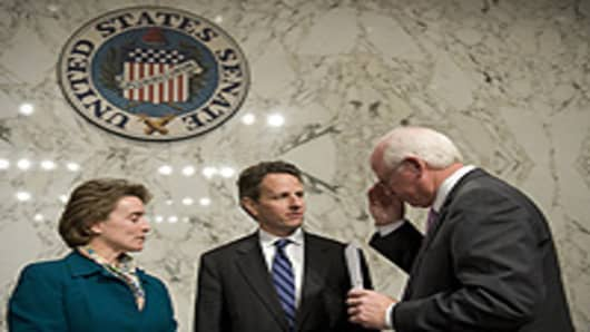 Treasury Secretary Timothy Geithner (C) speaks with Chair of the Senate Agriculture Committee Senator Blanche Lincoln (left), D-AR, and Senator Saxby Chambliss (R), R-GA.