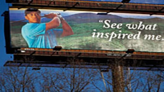 An outdoor billboard featuring an ad for The Cliffs High Carolina community which is planning a Tiger Woods designed golf course.