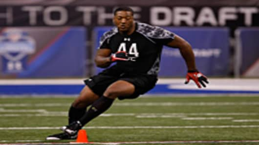 Offensive lineman Tony Washington runs during practice drills during the 2010 NFL Scouting Combine.
