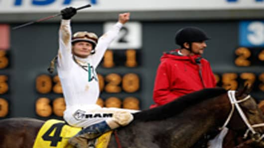Calvin Borel celebrates atop Super Saver after winning the 136th running of the Kentucky Derby on May 1, 2010 in Louisville, Kentucky.
