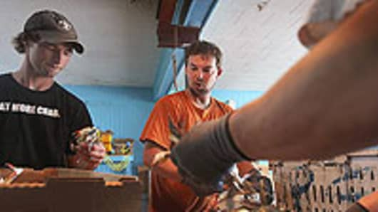 Cody Fonseca (left) and his brother Chris sort through blue crab caught in the Barataria-Terrebonne National Estuary at the La Blue Crab Company on May 3, 2010 in Larose, Louisiana,