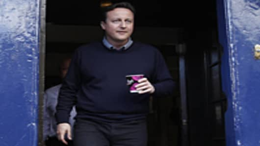 Britain's opposition Conservative Party leader David Cameron leaves a coffee shop during an election campaign stop in Woodstock, southern England.