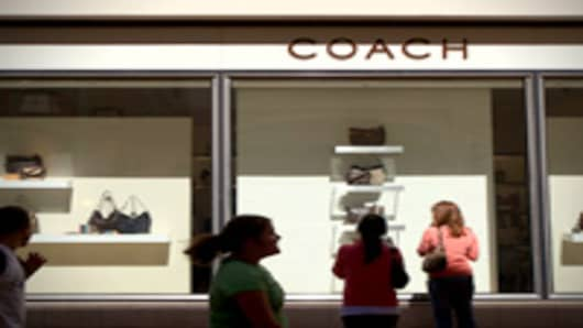 Shoppers look at handbags at a Coach store in Pasadena, California.