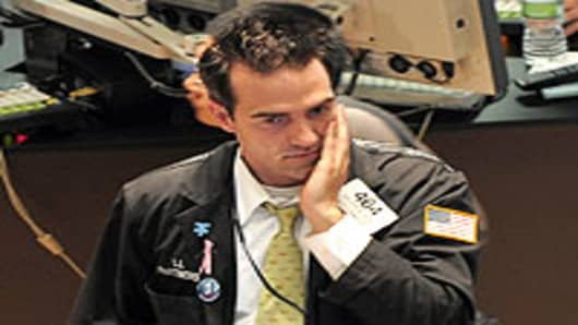 A concerned trader on the floor of the New York Stock Exchange.