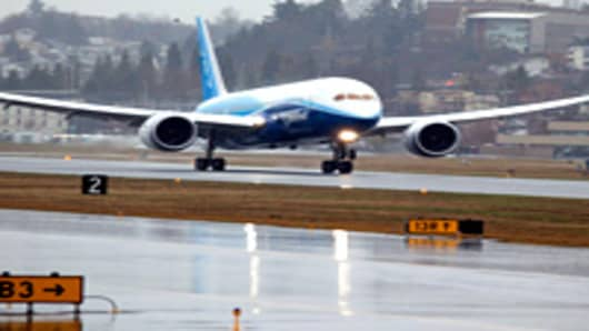 A Boeing 787 Dreamliner lands after its long-waited first flight.