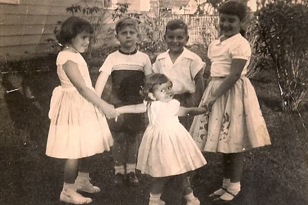 Candi Sosa (pictured far left with her sisters, brothers and a neighbor in pre-Castro Cuba) was just 10 years old when her parents sent her and her siblings to the United States. Her Pedro Pan story began with a song. It was just after the revolution and her parents sent her to buy milk at a corner store where she had a chance encounter with Fidel Castro, who had come in to buy cigars.People in the store told him Candi was a singer, so she obliged Castro with a song. Soon after, Castro's men arr
