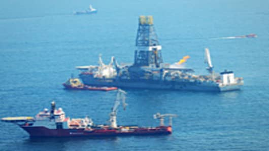 Offshore supply vessels assist and observe the worksite of the Deepwater Horizon oil rig explosion.