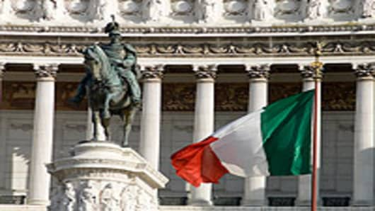 Statue and Italian Flag in front of Vittorio Emanuele monument.