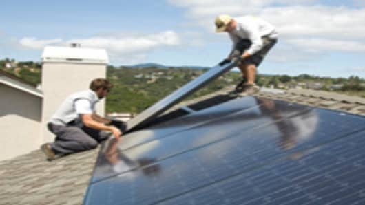 Westinghouse solar panels being installed on a roof.