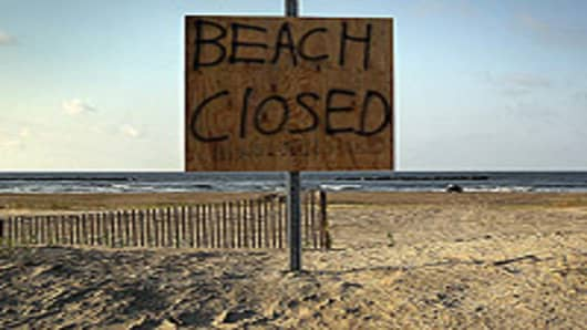 A sign warns the public away from the beach on Grand Isle, Louisiana. With oil covering many of the beaches, officials closed them to the public indefinitely on Saturday. Officials now say that it may be impossible to clean the coastal wetlands affected by the massive oil spill that continues gushing in the Gulf of Mexico.