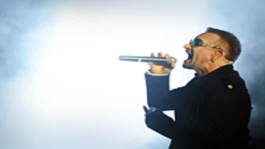 Bono singing at a U2 concert