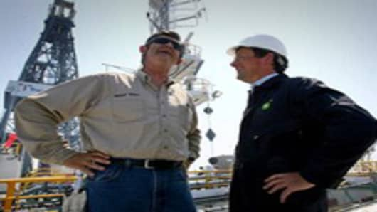 BP Wellsite leader George Walker (L) meets with CEO of BP Tony Hayward aboard the Discover Enterprise drill ship during recovery operations in the Gulf of Mexico 55, miles south of Venice, Louisiana.