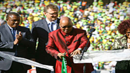 South African president Jacob Zuma cuts a ribbon at the official opening of Soccer City on May 22, 2010 in Soweto, South Africa.