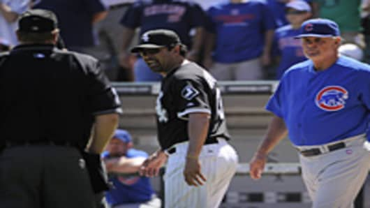 Managers Ozzie Guillen of the Chicago White Sox and Lou Piniella of the Chicago Cubs