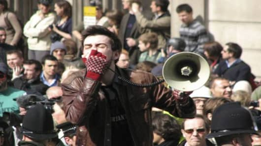 Tens of thousands of people voiced their anger at the world economic crisis in London's financial district in April 2009, one day before a summit by leaders of the G20 countries in Europe's financial capital.