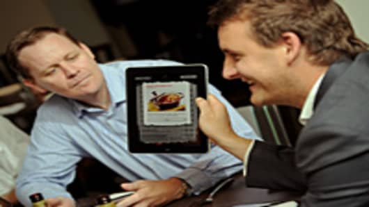 Diners use an Apple iPad to order food.
