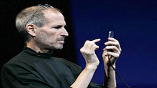 Apple CEO Steve Jobs demonstrates the new iPhone 4.