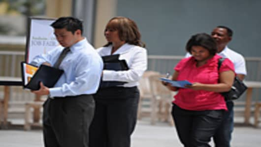 Job seekers wait in line to have their résumés reviewed at the second annual Anaheim/Orange County Job Fair.