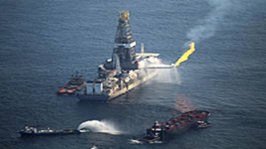 A flare burns from a drill ship recovering oil from the ruptured British Petroleum oil well over the site in the Gulf of Mexico on June 9, 2010 off the coast of Louisiana. The spill has been called the largest environmental disaster in American history.