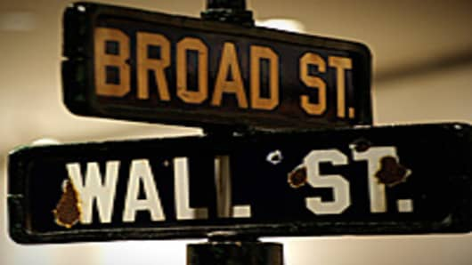 A vintage street sign that stood at the intersection of Manhattan's Wall Street and Broad Street is on display at Christie's, in New York, June 18, 2010. The late 19th century to early 20th century pop-top style street sign will go on auction on June 22, 2010.