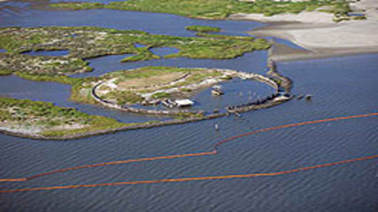Booms laid for protection at Breton National Wildlife Refuge, near Venice, LA.