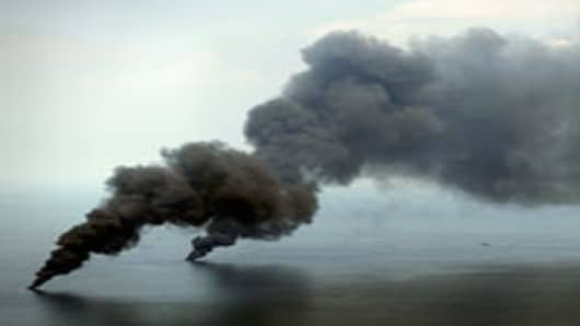 Oil burns and creates plumes of smoke near the site of the Deepwater Horizon oil spill on June 19, 2010 in the Gulf of Mexico off the coast of Louisiana.