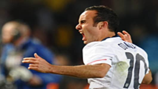 Landon Donovan celebrates after beating Algeria in their 2010 World Cup Group C first round match in Tshwane/Pretoria.