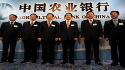 From left to right, Pan Gongsheng, executive director Agricultural Bank of China (AgBank), Zhu Hongbo, vice president, Zhang Yun, vice chairman, Xiang Junbo, chairman and executive director, Yang Kun, executive director and Guo Haoda, executive vice president attend a photo call in Hong Kong.