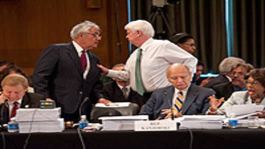 House Financial Services Chairman Barney Frank, D-Mass., standing, consults with Senate Banking Chairman Christopher J. Dodd, D-Conn., during the House-Senate conference on a comprehensive financial regulatory overhaul bill.