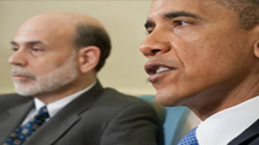 US President Barack Obama speaks alongside Chairman of the Federal Reserve Ben Bernanke during the Economic Daily Briefing.