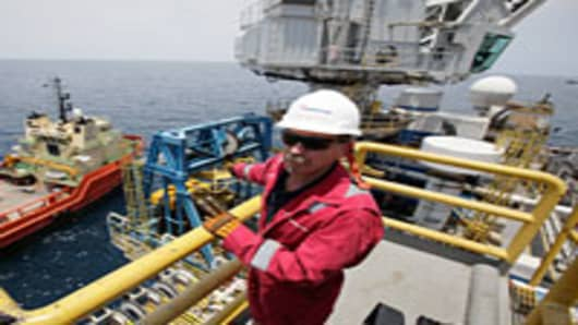Transocean Offshore Installation Manager Chris Wokowsky stands on the deck of the Development Driller II, which is drilling a relief well, at the site of the Deepwater Horizon oil spill in the Gulf of Mexico off the coast of Louisiana.