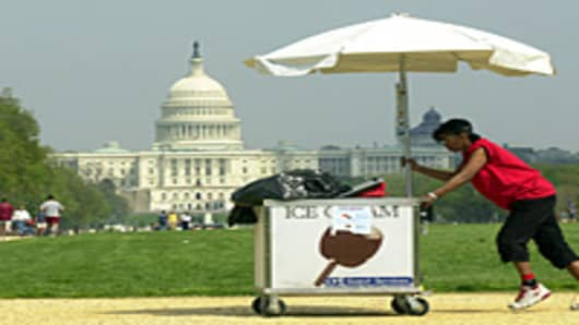 An ice cream vendor pushes her cart near the U.S. Capitol on the National Mall in Washington, DC.