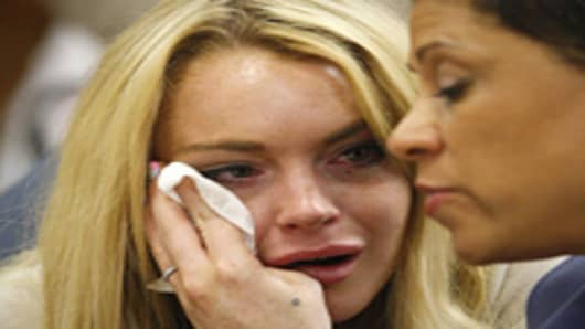 Lindsay Lohan cries next to her lawyer Shawn Chapman Holley as she is sentanced to 90 days jail by Judge Marsha Revel during her hearing at the Beverly Hills Courthouse.