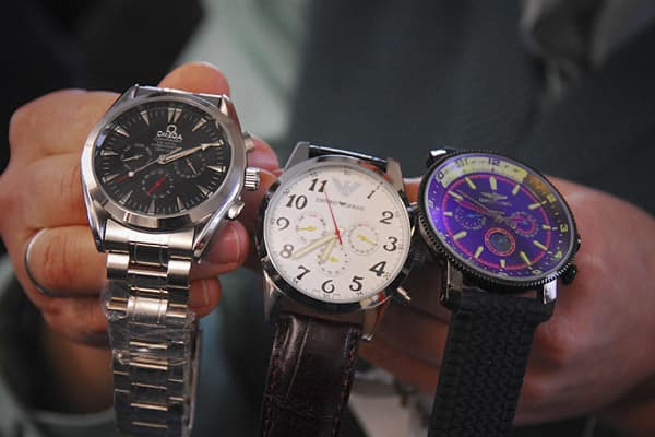2009 Domestic Seizure Value: $15.53 millionPercent of Total Seizures: 6% A customs officers displays counterfeit watches that were seized over the past months in Hamburg, Germany.