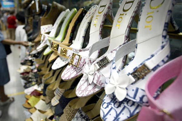 2009 Domestic Seizure Value: $ 99.78 million     Percent of Total Seizures: 38% Counterfeit name-brand shoes on display at a Beijing clothing market.