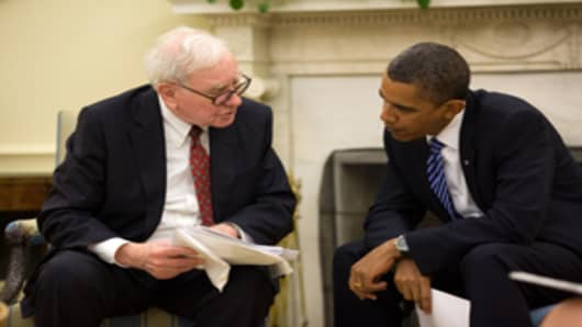 Warren Buffett discusses the economy with President Barack Obama during an Oval Office meeting on July 14, 2010.
