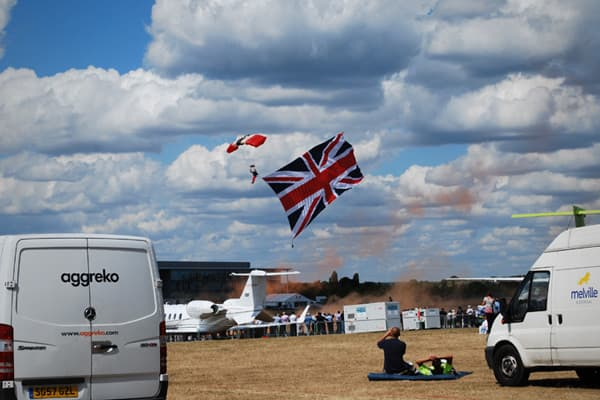 """Reminiscent of the start of the title sequence in the James Bond movie """"The Spy Who Loved Me,"""" the Farnborough parachuting display included a finale featuring a huge Union Jack flag."""
