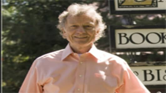 Sam Wyly poses in front of his Explore book store, Aspen, Colorado, in 2008.