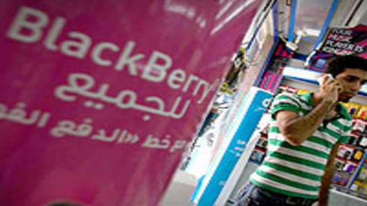 A sign advertising the BlackBerry mobile phone is seen at a shopping mall in Dubai on August 01, 2010