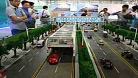 Viewers take in a scale model of China's 3D Fast Bus.