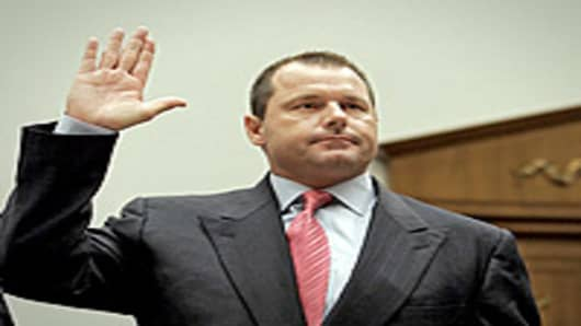 Roger Clemens being sworn in before testifying before US House Oversight and Government Reform Committee hearing on Capitol Hill on February 13, 2008.