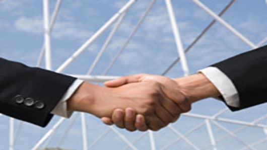 shaking_hands_2_200.jpg