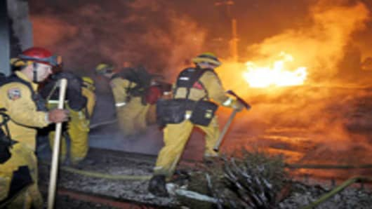 Firefighters race to fire in San Bruno, California.
