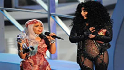 Lady Gaga accepts award from Cher on stage at the 2010 MTV Video Music Awards.