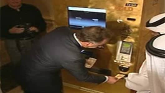 Demonstration of the gold dispensing ATM in Abu Dhabi.