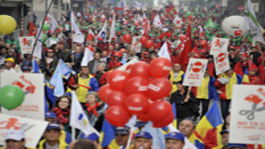 People demonstrate to say ''no to austerity'', in Brussels. Police threw a ring of steel around EU headquarters as tens of thousands in a sea of banners from across Europe took to the streets in a worker backlash against painful spending cuts. The protest, the biggest such march since 2001 when 80,000 people invaded the Belgian capital, was timed to coincide with an EU plan to fine governments running up deficits.