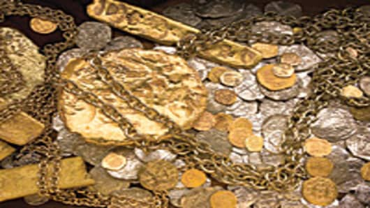 A sample of gold bars, coins and jewelry recovered from the $450 million treasure cache discovered on the Atocha shipwreck.